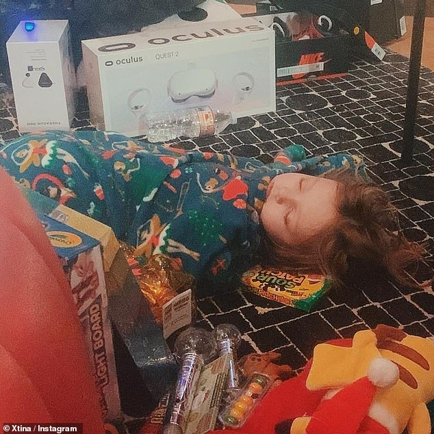 Swooned: Christina also shared a sweet photo of their six-year-old daughter, Summer Rain, wearing her pajamas on the floor after the inaugural gifts