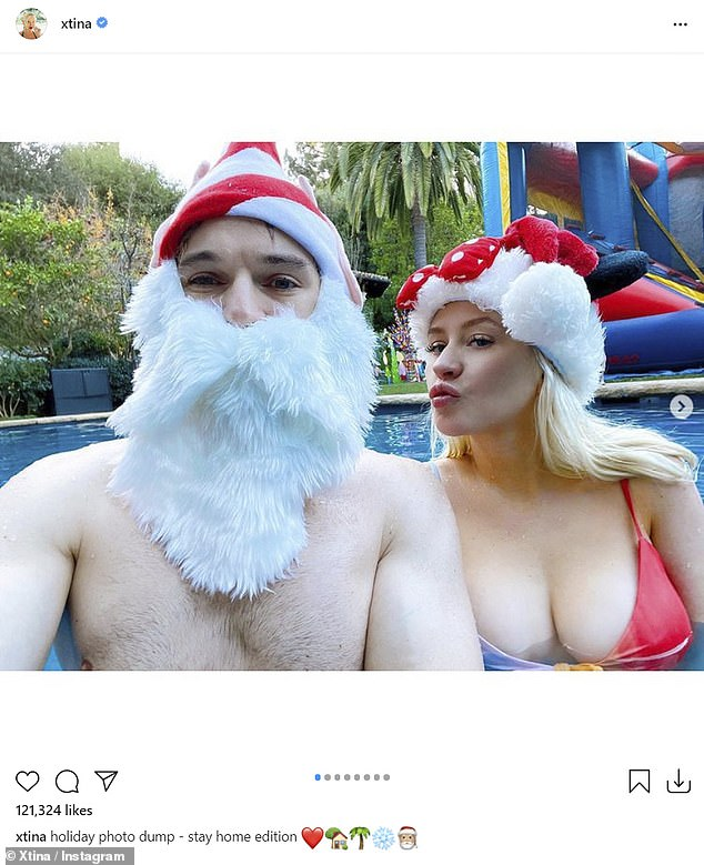 Christina Aguilera rocks a rotten red bikini as she orders some fake snow for Christmas by the pool